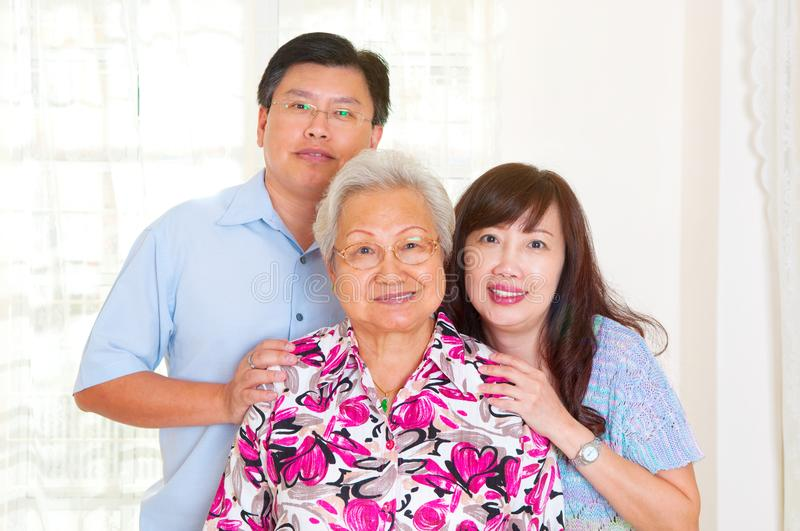 Asian senior woman and children stock image