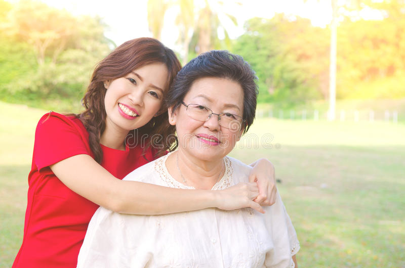 Asian senior woman and daughter royalty free stock photos