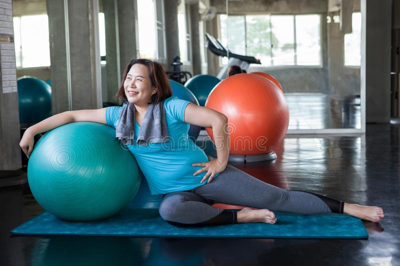 asian Senior woman Doing yoga in fitness gym. aged lady exercising.  Old female workout .Mature fat sport training.rehabilitation. stock image
