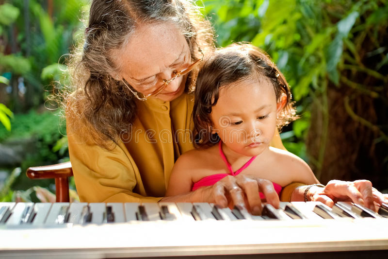 Download Asian Senior Woman Teach Child Playing Piano Stock Image - Image: 23527179