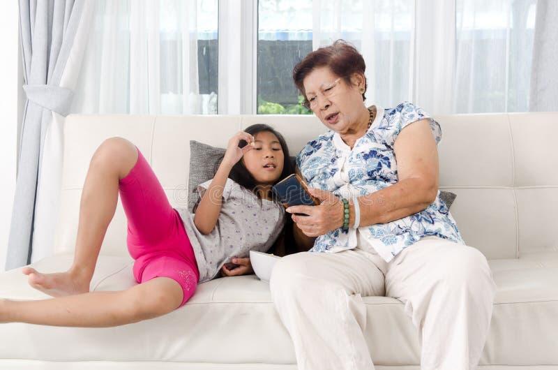 Asian senior woman using smart phone royalty free stock photo