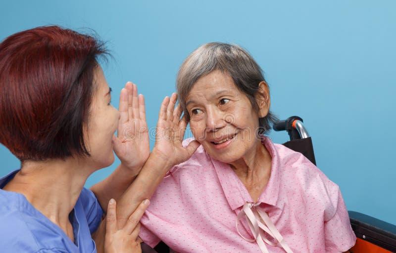 Asian seniors woman hearing loss , Hard of hearing stock photos
