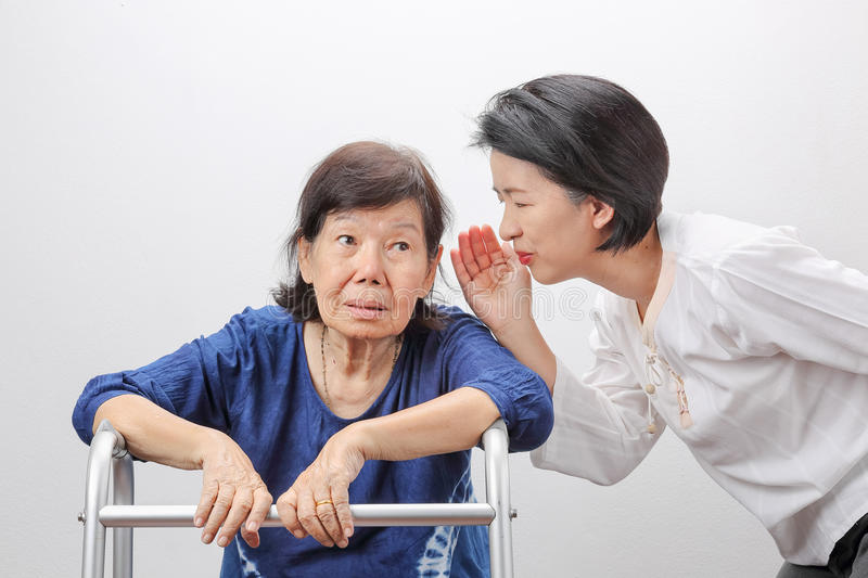 Asian seniors woman hearing loss ,Hard of hearing royalty free stock photos