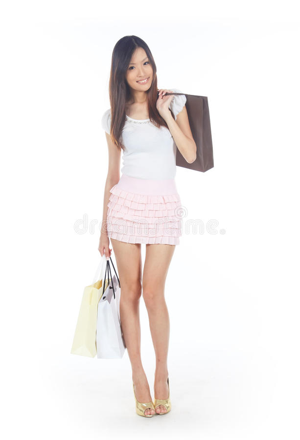 Asian Shopper. With Shopping Bags on White stock image