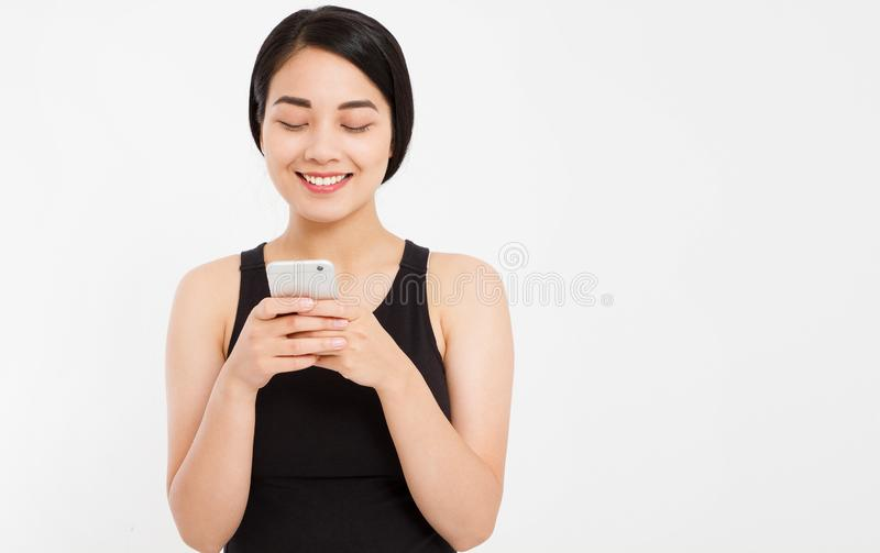 Asian smile girl using cellphone isolated on white background stock photography