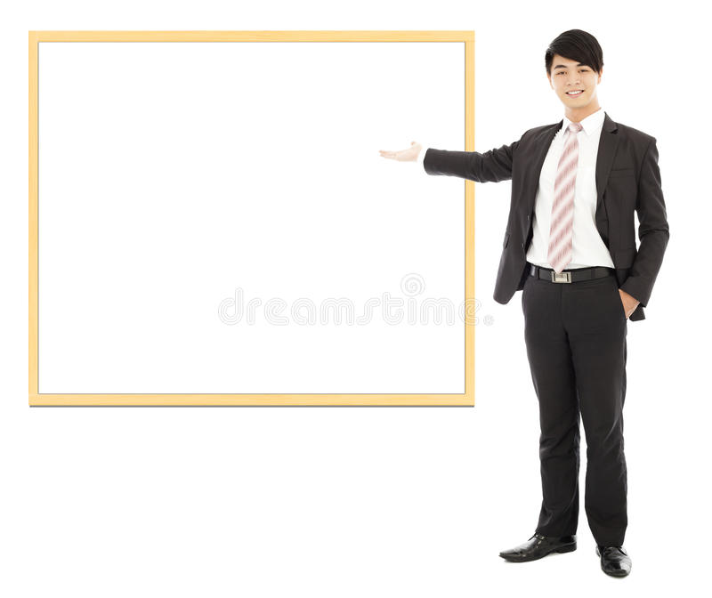 Asian smiling business man pointing blank board. Isolated on white background stock photos