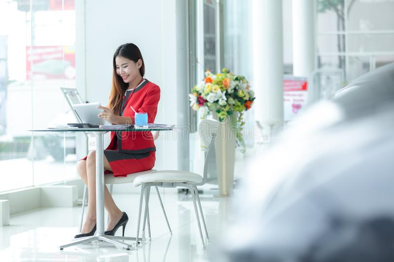 Asian smiling successful businesswoman in suit talking on phone stock photos