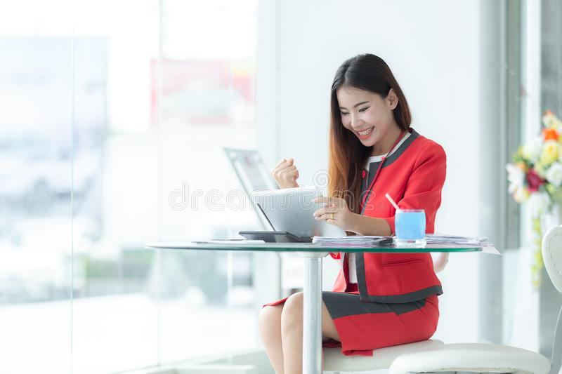 Asian smiling successful businesswoman in suit talking on phone royalty free stock photo