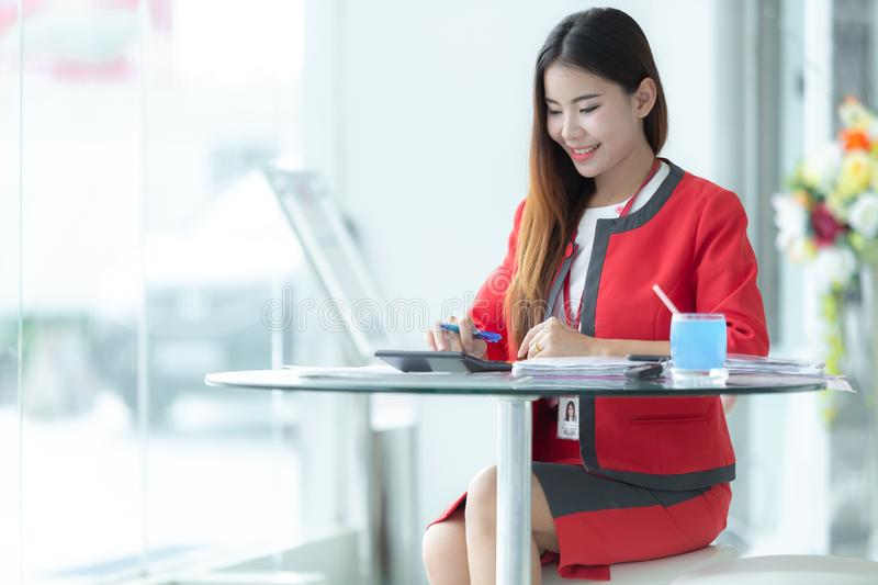 Asian smiling successful businesswoman in suit talking on phone royalty free stock photography