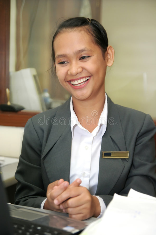 Asian smiling at work royalty free stock image