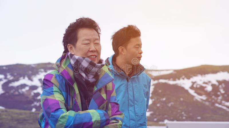 Asian son take senior mother to travel together in Iceland family bond stock photos