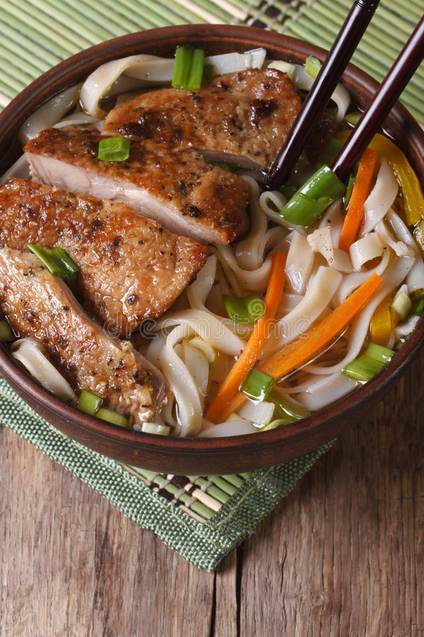 Asian soup with duck and rice noodle and chopsticks. top view royalty free stock photography