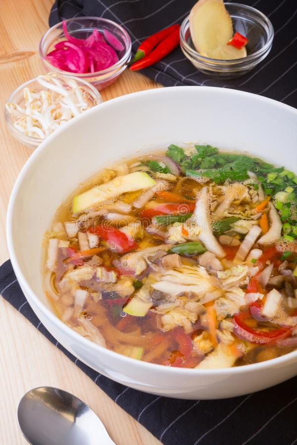 Asian soup of mixed vegetables served with ingredients. Asian soup of mixed vegetables served with different ingredients stock photos
