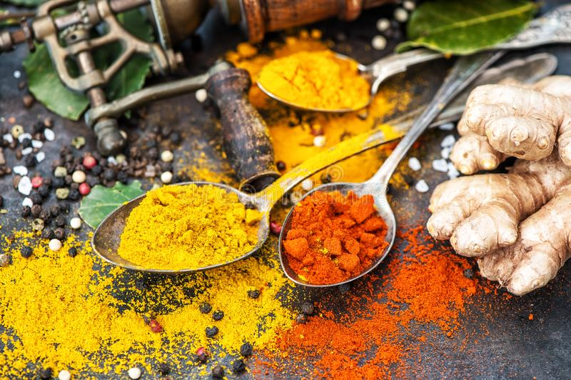 Asian spices dark table background Curry turmeric ginger bay lea. Asian spices on dark table background. Curry, turmeric, ginger, bay leaf stock image