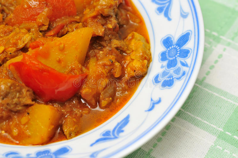 Asian spicy mutton curry. Cooked with potatoes and tomatoes stock images