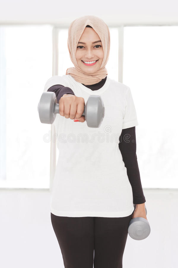 Asian sporty woman lifting dumbbells stock images