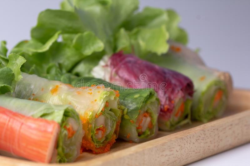 Asian Spring roll with mix vegetables on wooden plate royalty free stock photography