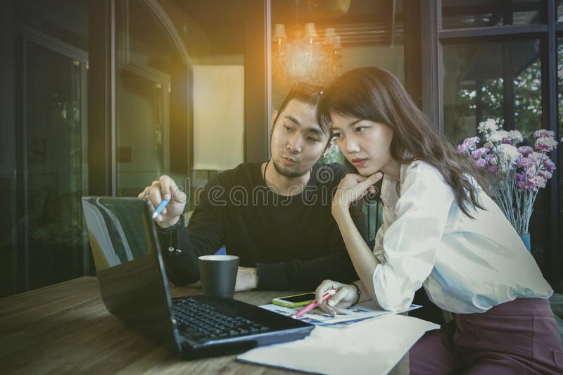 Asian start up ,freelance team working with computer laptop at h stock image