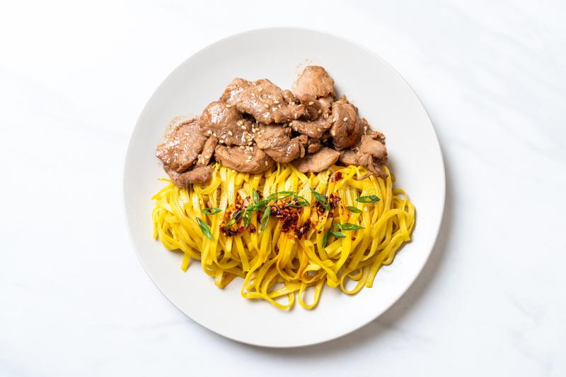 Asian stir-fried noodle with pork. And chili paste stock photos