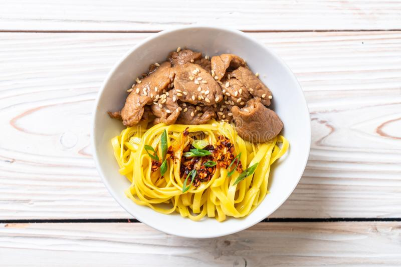 Asian stir-fried noodle with pork. And chili paste royalty free stock photos