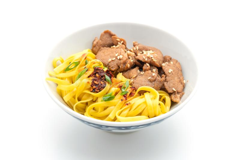 Asian stir-fried noodle with pork. And chili paste isolated on white. background stock photography