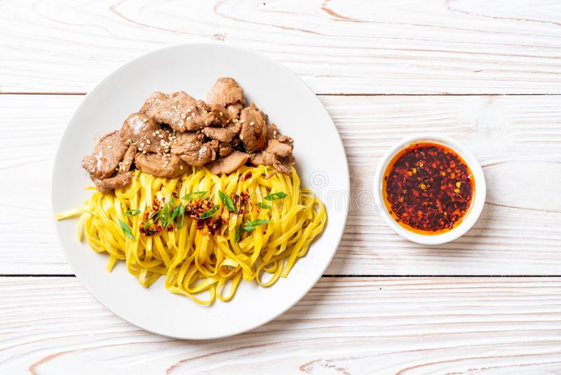Asian stir-fried noodle with pork. And chili paste royalty free stock images