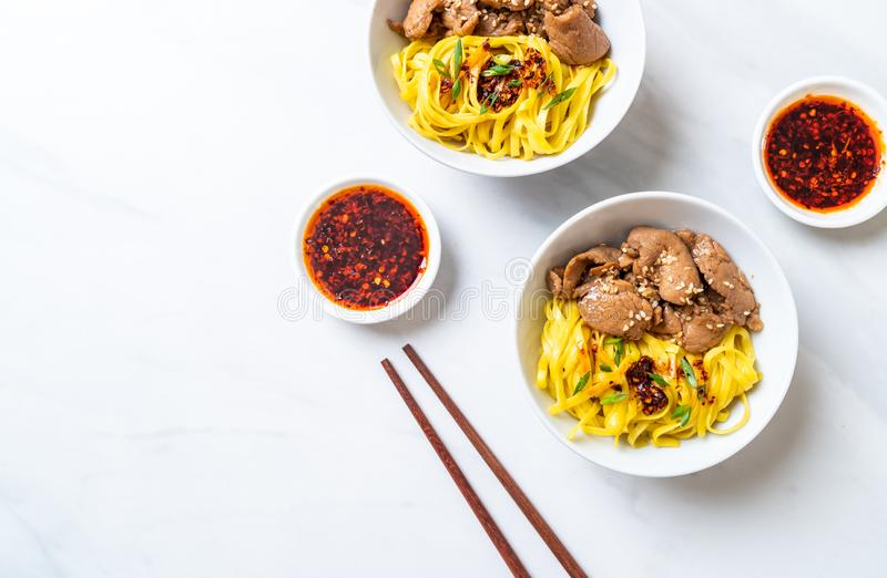 Asian stir-fried noodle with pork. And chili paste royalty free stock photography