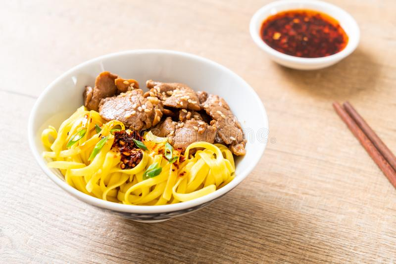 Asian stir-fried noodle with pork. And chili paste stock photography