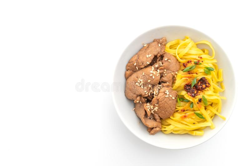 Asian stir-fried noodle with pork. And chili paste isolated on white. background royalty free stock photo