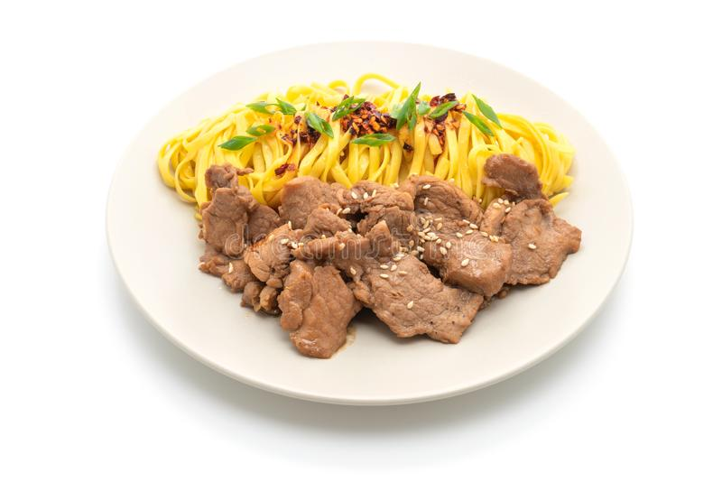 Asian stir-fried noodle with pork. And chili paste isolated on white. background royalty free stock photography