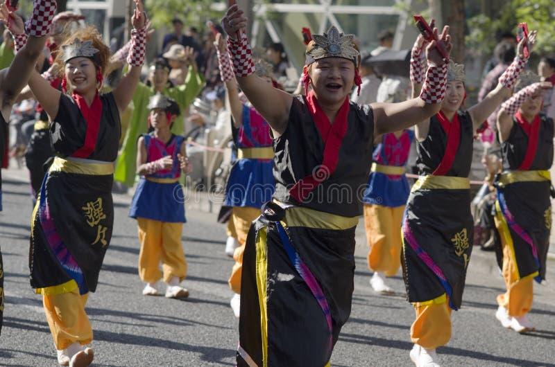 Asian street festival fun. Smiling people in regional costumes in a street parade at 62nd Nagoya Matsuri Festival, Japan stock photos