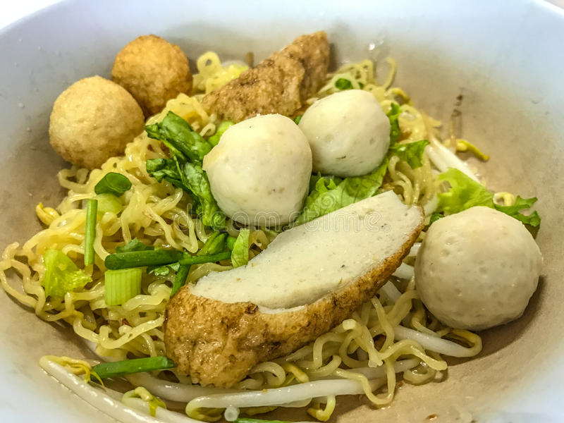 Asian Street Food. Closeup Egg noodle with varieties of fish meatballs.  royalty free stock photo