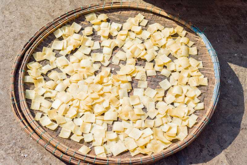 Asian street market selling raw pasta dough in Vietnam. Asian street farmer market selling raw pasta dough which will be dried up in the sun in Hoi An, Vietnam royalty free stock photography