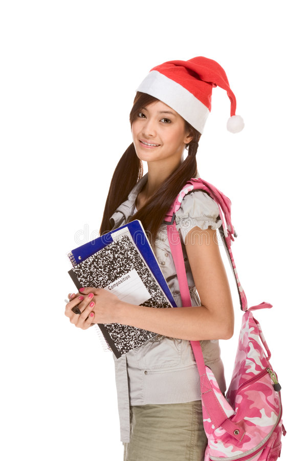 Asian student girl in Christmas Santa hat and bag royalty free stock photos