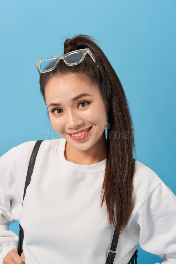 Asian student girl over isolated blue wall happy and smiling royalty free stock image