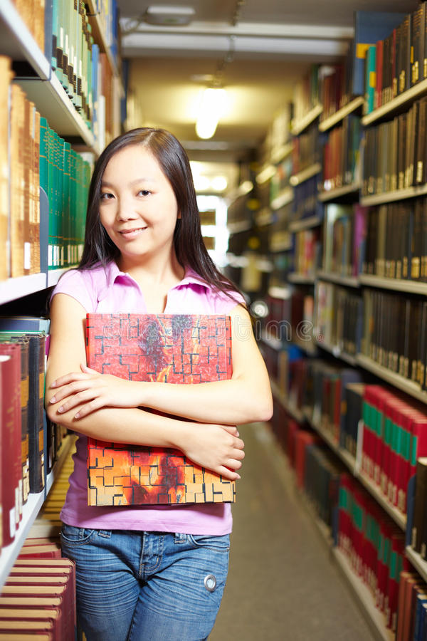 Asian student in library stock images