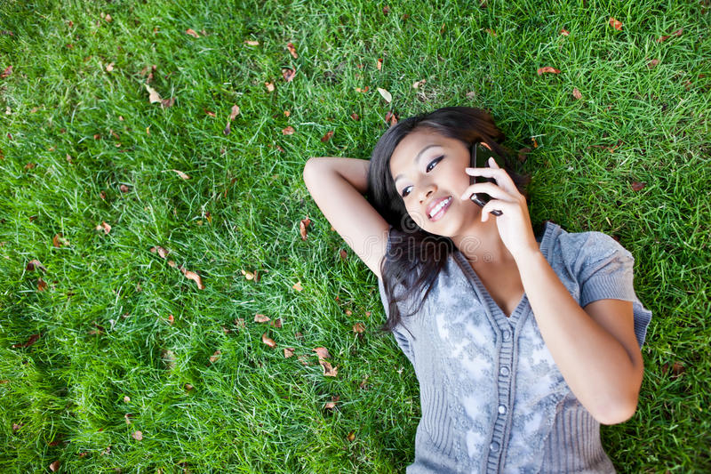 Asian student on the phone royalty free stock image