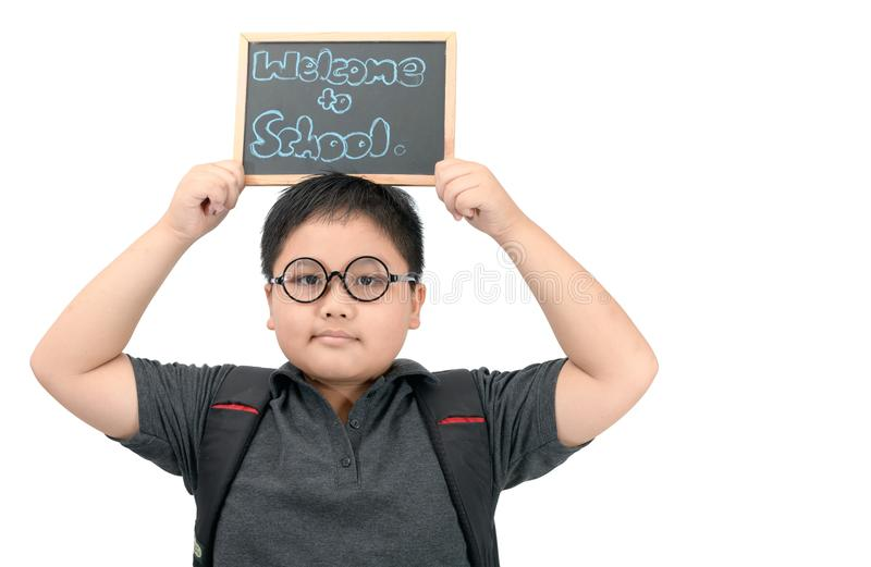 Asian student showing welcome to school chalkboard stock photography