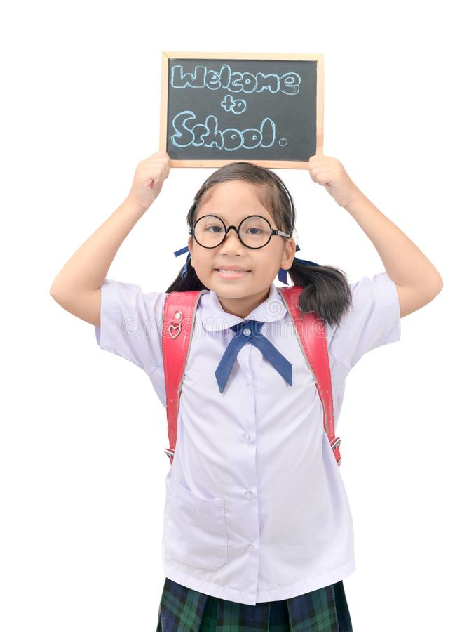 Asian student showing welcome to school chalkboard royalty free stock photo