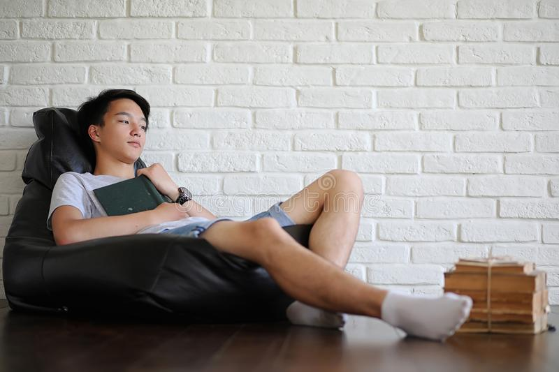 Asian student sitting on pillow and getting ready for exam stock photos
