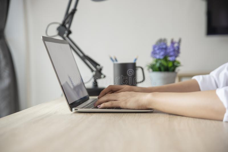 Asian Student typing report and research in library. stock images