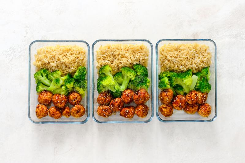 Asian style chicken meat balls with broccoli and rice in a take. Asian style teriyaki sauce chicken meat balls with broccoli and rice prepared and put in a take royalty free stock images