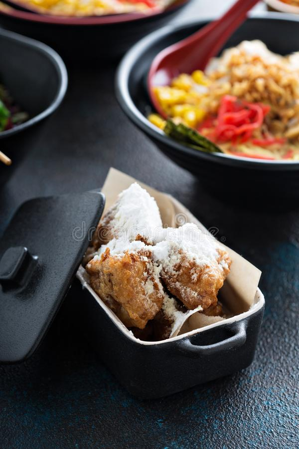 Asian style fried donuts with powdered sugar royalty free stock images