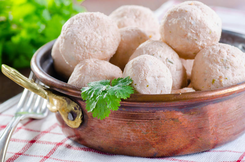 Asian style meatballs in a bowl. Asian style fish and prawn meatballs in a bowl with saffron and yogurt sauce stock images