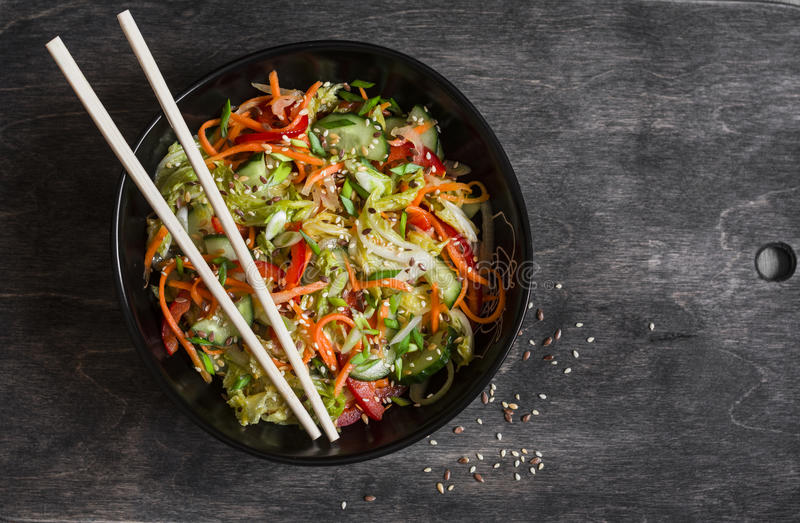 Asian style pickled vegetables salad on dark background. Top view royalty free stock image