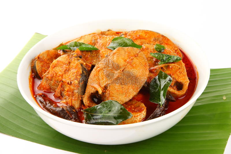 Asian style tuna fish curry.served in white bowl. With banana leaf background stock photography