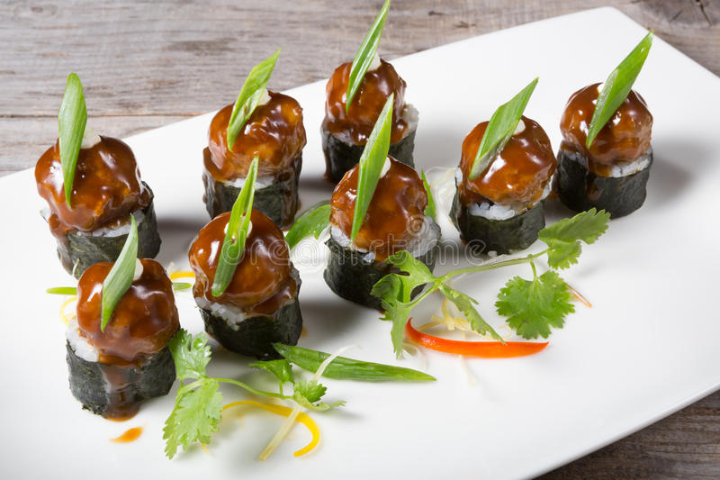 Asian styled meatballs. Served on a white plate stock image