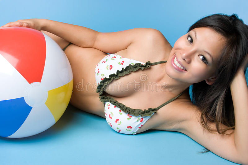 Asian Summer Girl. Asian beach ball summer girl royalty free stock image
