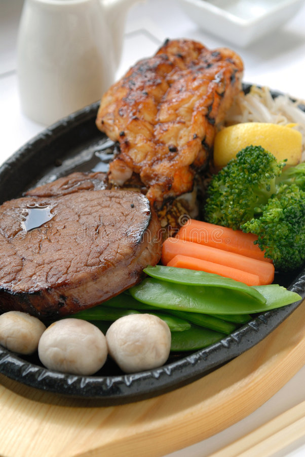 Asian surf and turf. With vegetables royalty free stock image