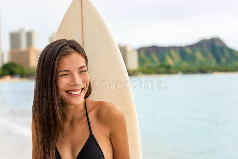 Asian surfer girl smiling portrait. Surfing woman with surfboard on Waikiki beach, Hawaii, USA travel surf lifestyle stock images